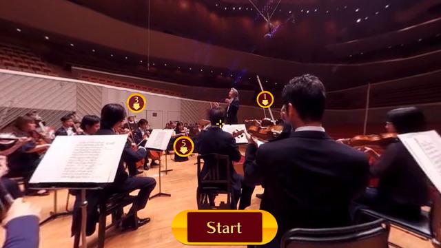 ヴァイオリン奏者の間に置かれたカメラから。前後左右、どこを向いても演奏に集中している団員の姿がある