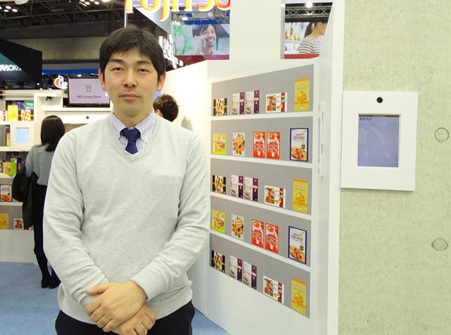 店舗自動化システムの展示を担当するNECの山崎晋哉氏