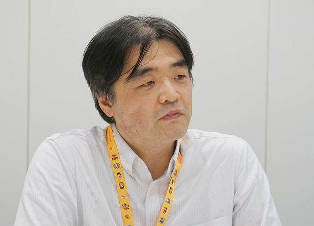 最新鋭のiMac Proによって担当するビルド作業が飛躍的に効率化されたと語る齋藤氏